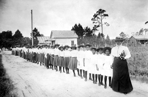Mary McLeod Bethune with her students at the Dayton School